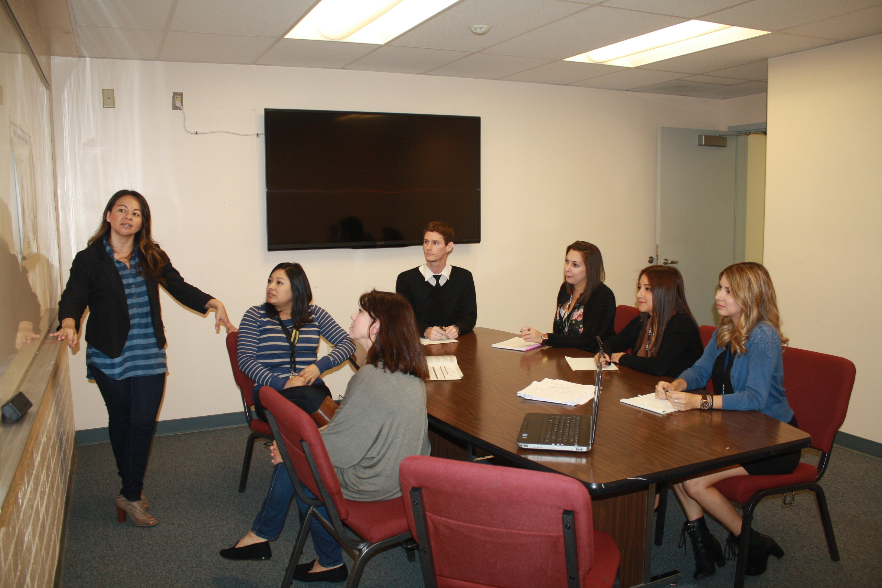 whittier union launches student well being program student well being liaison angela castellanos leads a whytry training seminar for a group of master and bachelor level social work interns who are